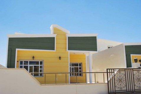 بيت للبيع في كنجان من الباصو07508433333